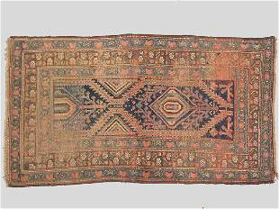 An antique Kurdish Oriental rug, with overall
