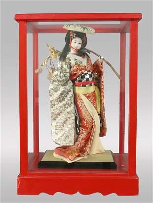 "A Japanese Beijin ""Geisha"" doll with branch set"