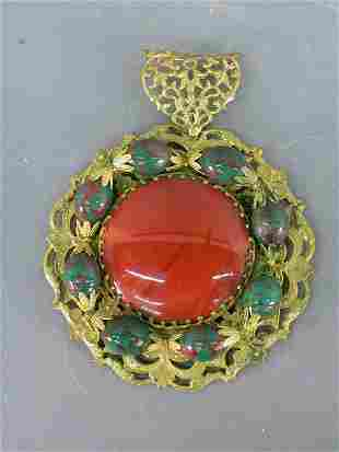 A signed Miriam Haskell pendant with a fillagree