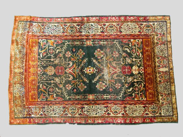 An Antique silk Heriz. Several areas of damage