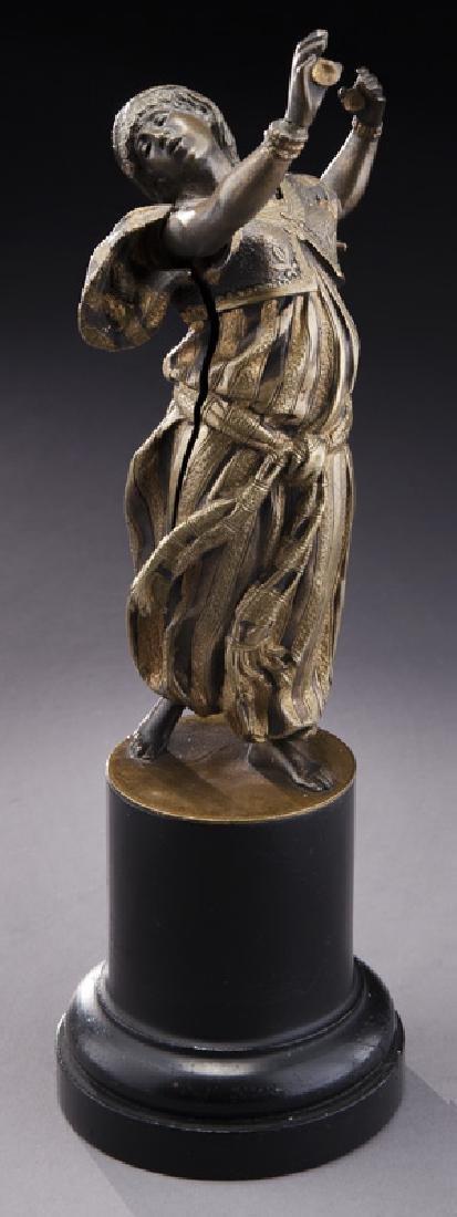 Erotic parcel gilt bronze figure of a woman,