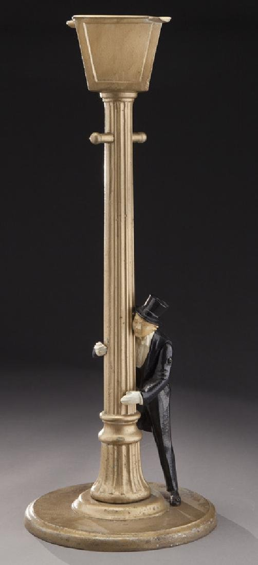 Art Deco figural cast iron standing ashtray,