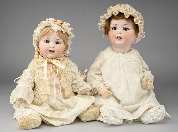414: (2) German bisque Character baby dolls