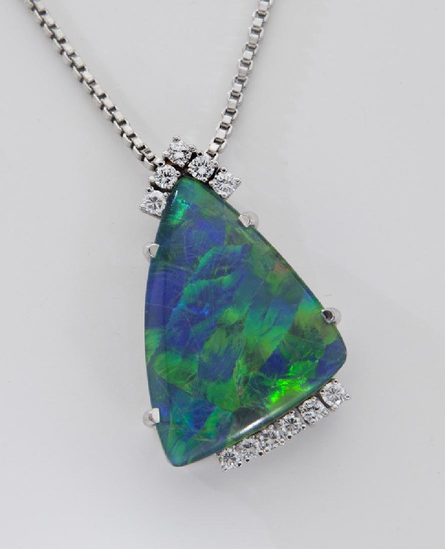 18K white gold, diamond and black opal triplet