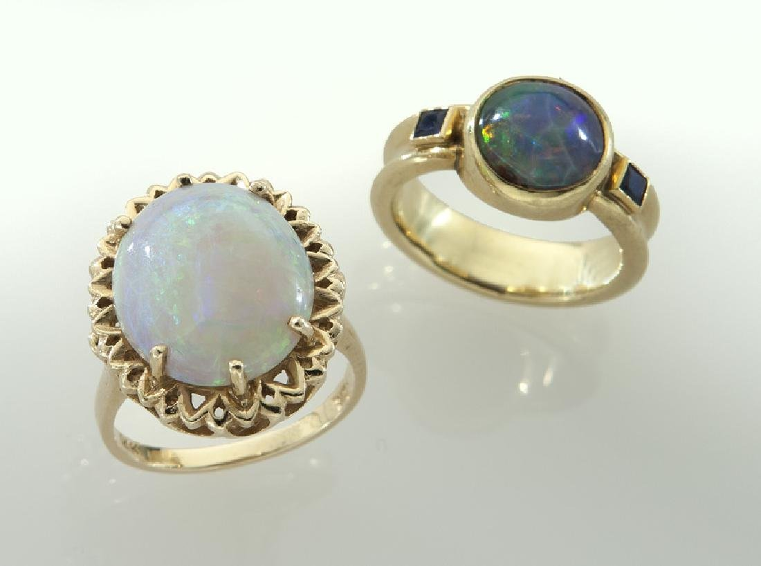(2) 14K gold and opal rings.