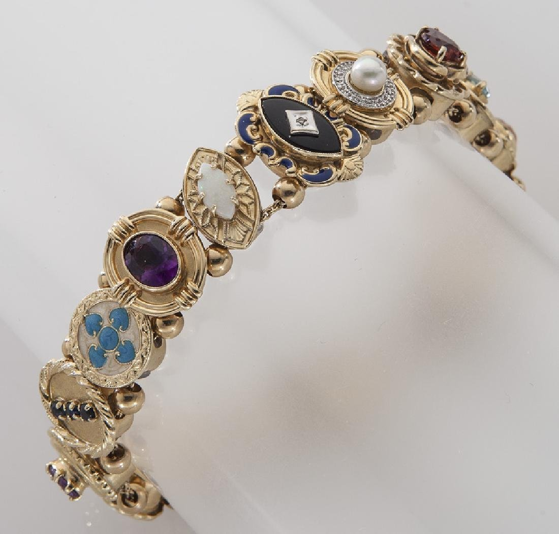 Retro 10K gold slide bracelet mounted with charms