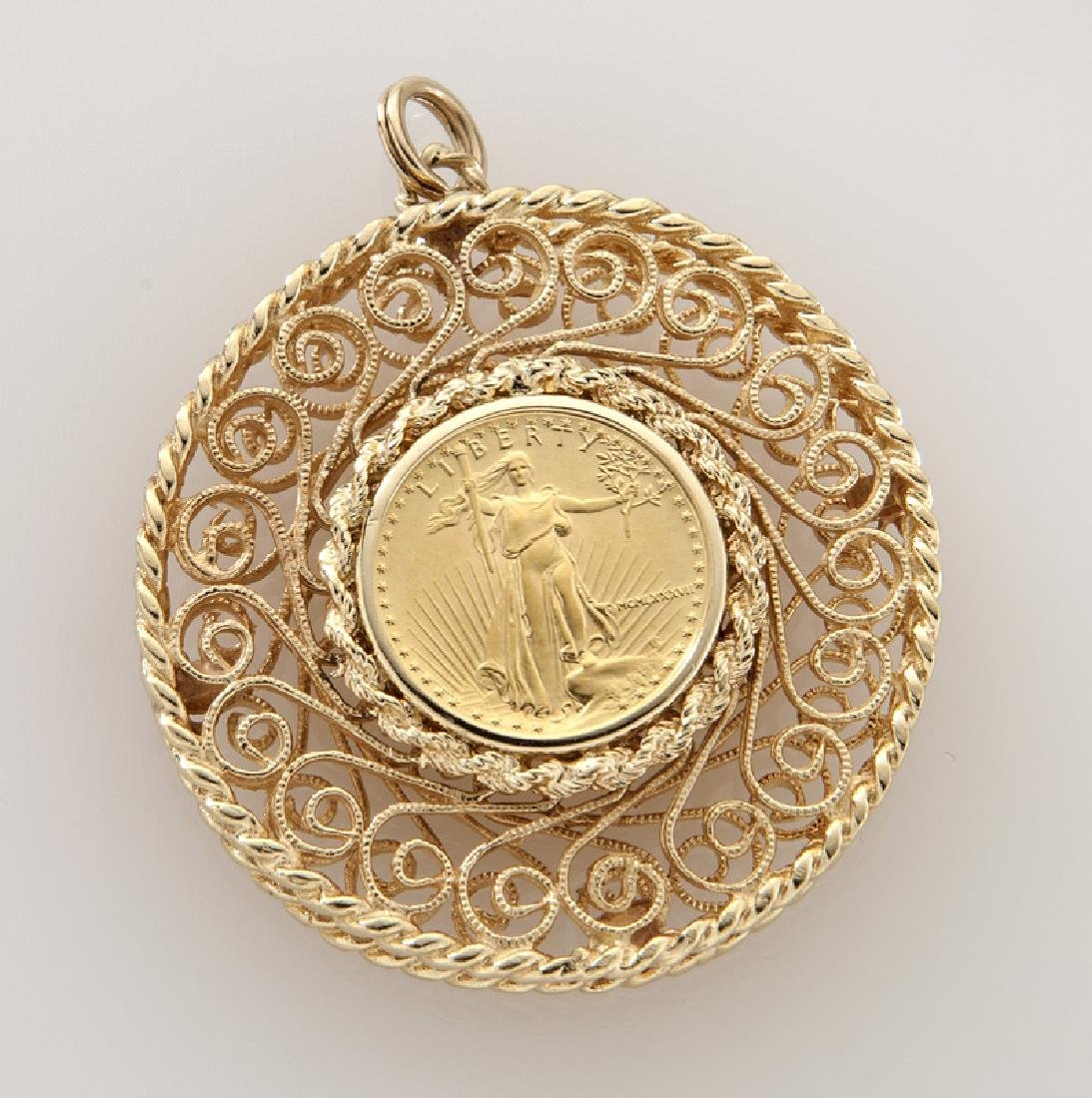 Liberty $5 gold coin in a 14K frame.