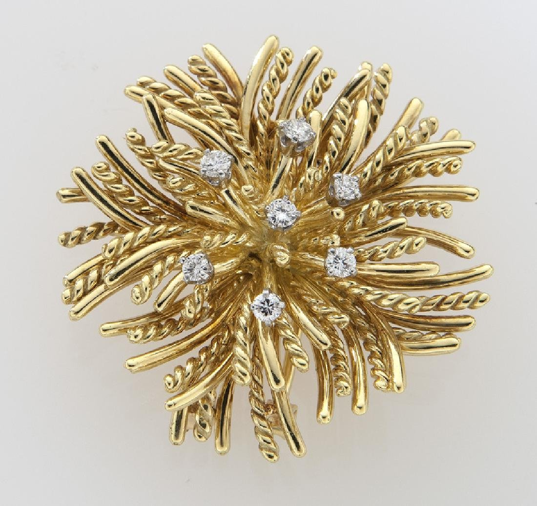 Retro 18K gold and diamond brooch in a flame