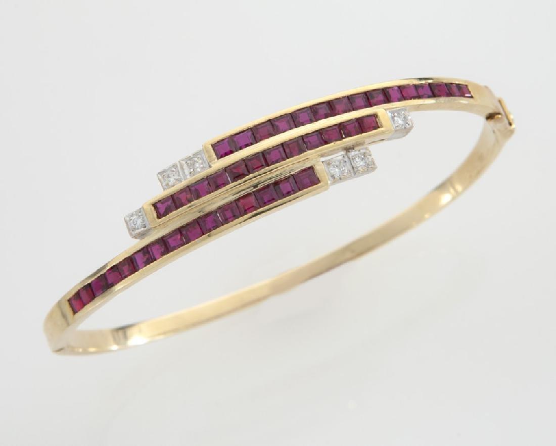 18K gold, diamond and ruby triple bypass bracelet.