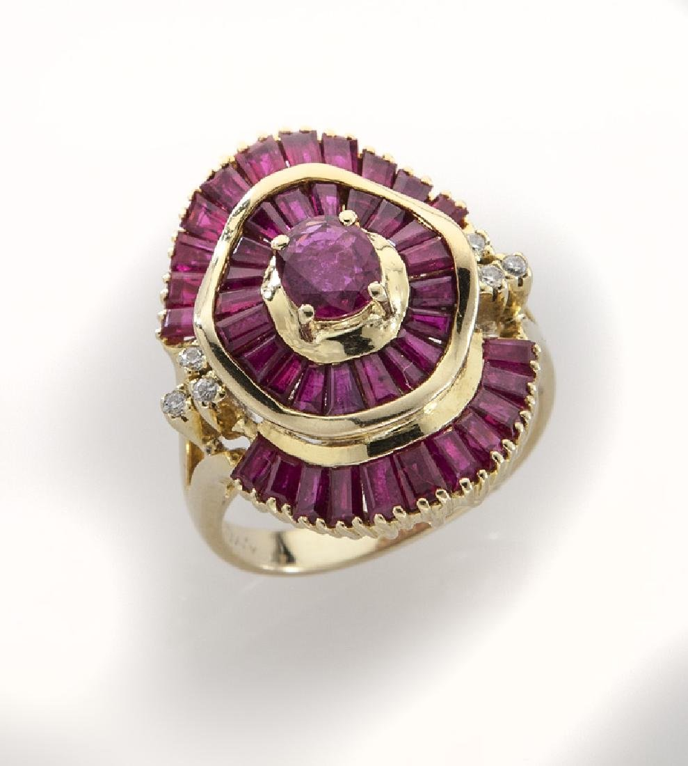18K gold, diamond and ruby ballerina style ring.