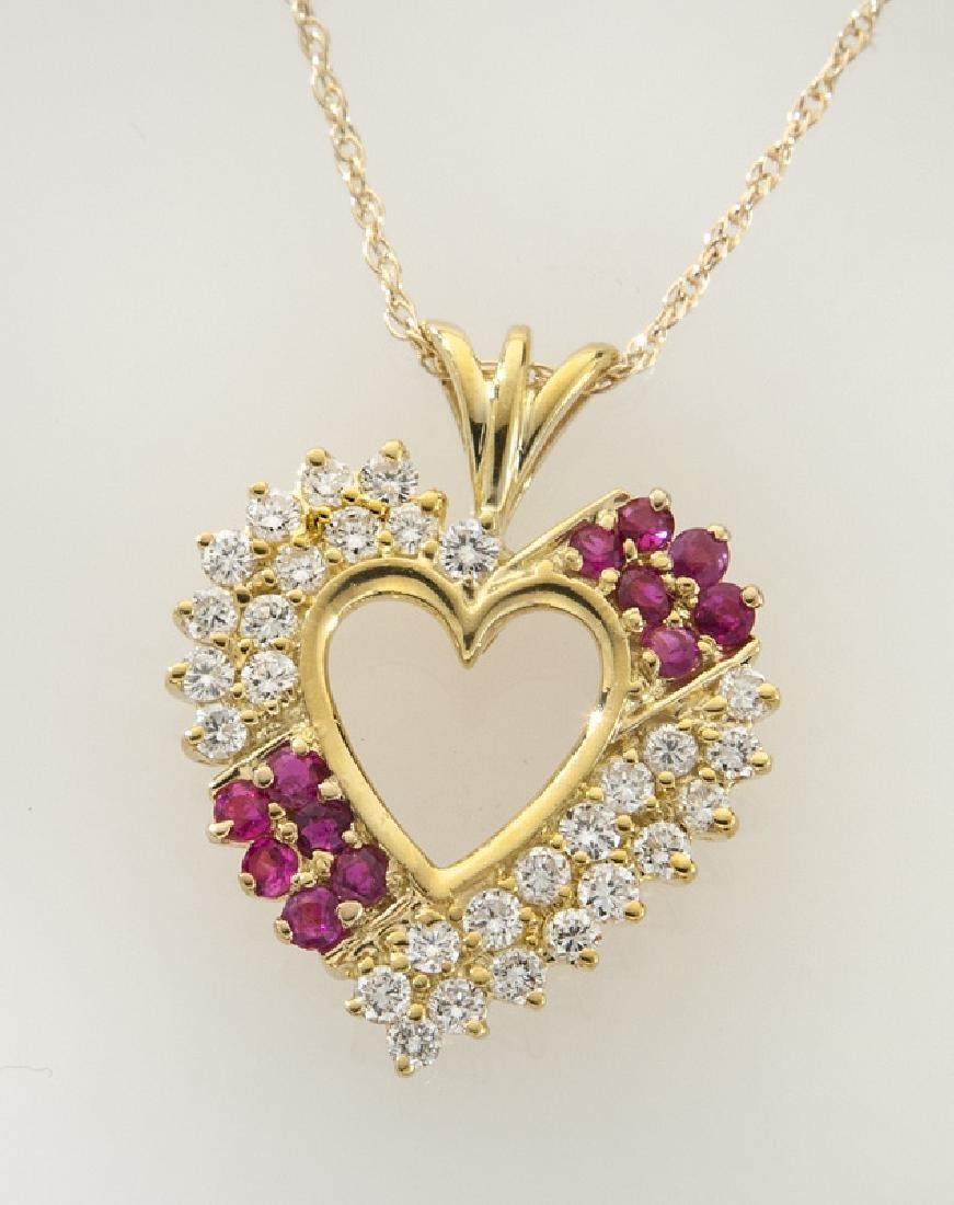14K gold, diamond and ruby heart shaped pendant