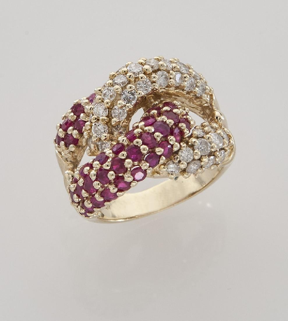 14K gold, diamond and ruby double knot ring.