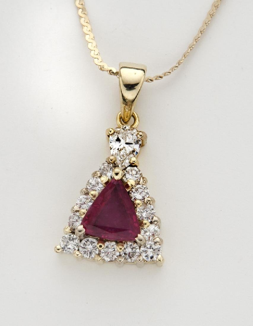14K yellow gold, diamond and ruby necklace.