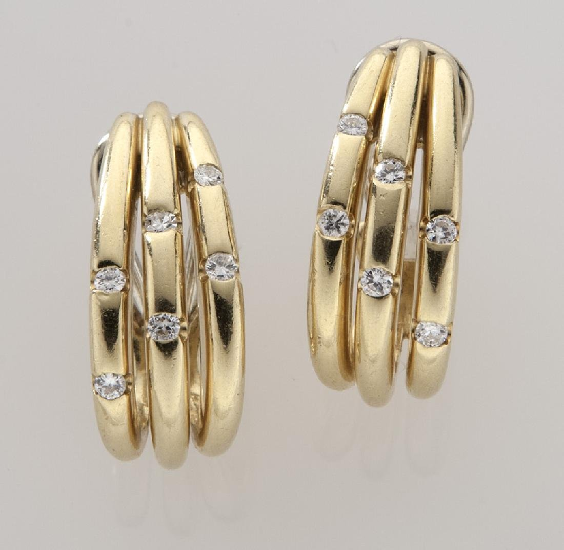 Pair of 18K gold and diamond earclips.