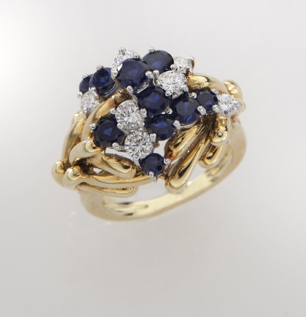 Retro platinum, 18K, diamond and sapphire ring.
