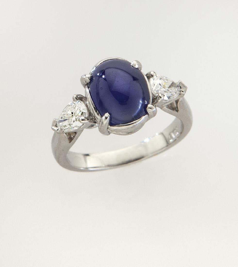 Platinum, diamond and star sapphire ring,