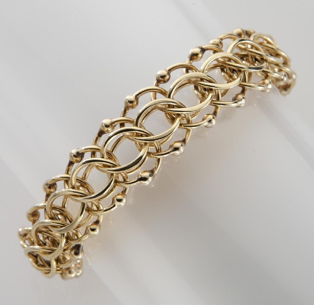 14K yellow gold circular link bracelet.