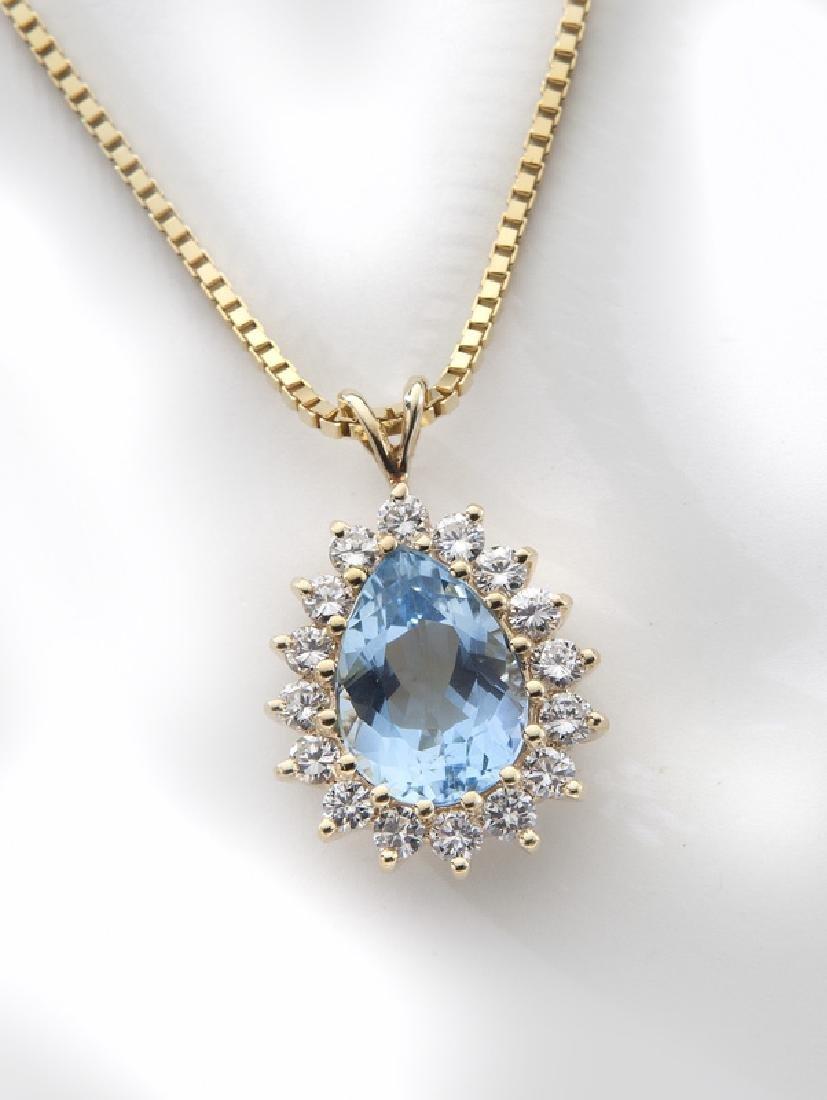 14K yellow gold, diamond and aquamarine necklace.