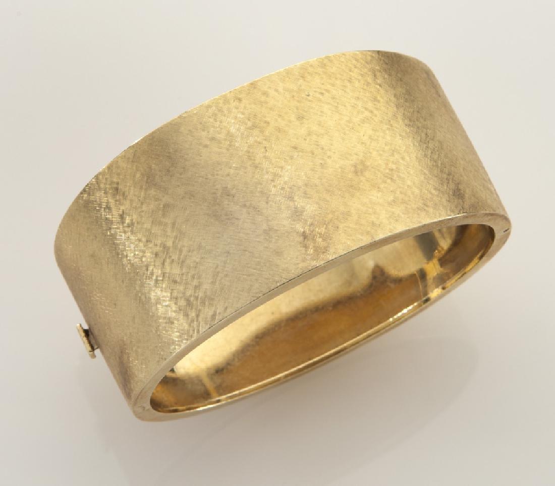 14K gold bangle bracelet with Florentine finish.