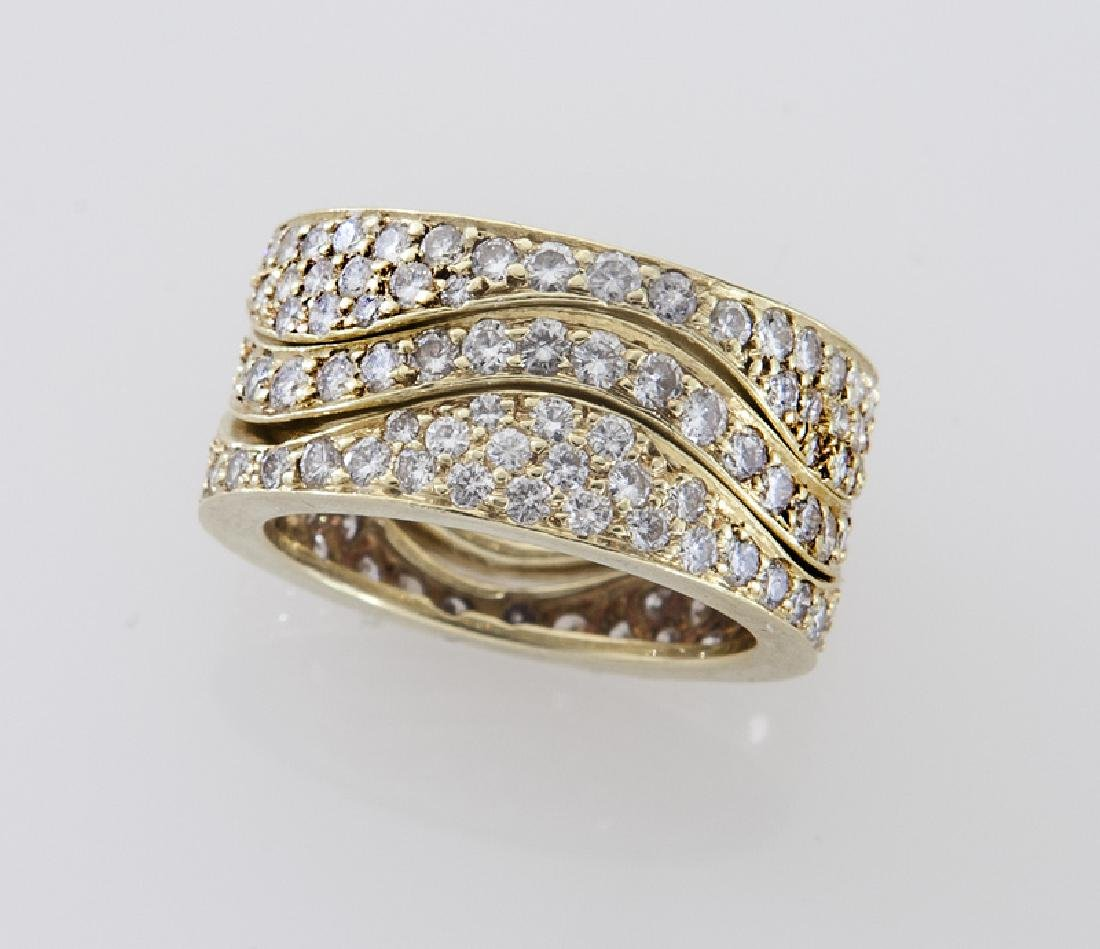 (3) 18K gold and diamond stacking rings.
