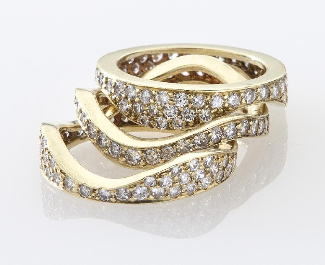 (3) 18K gold and diamond stacking rings. - 2