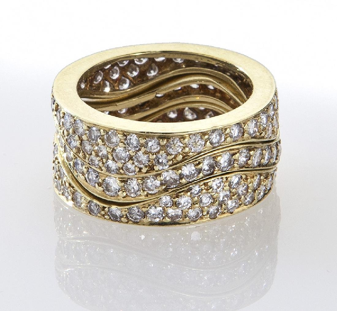 (3) 18K gold and diamond stacking rings. - 3