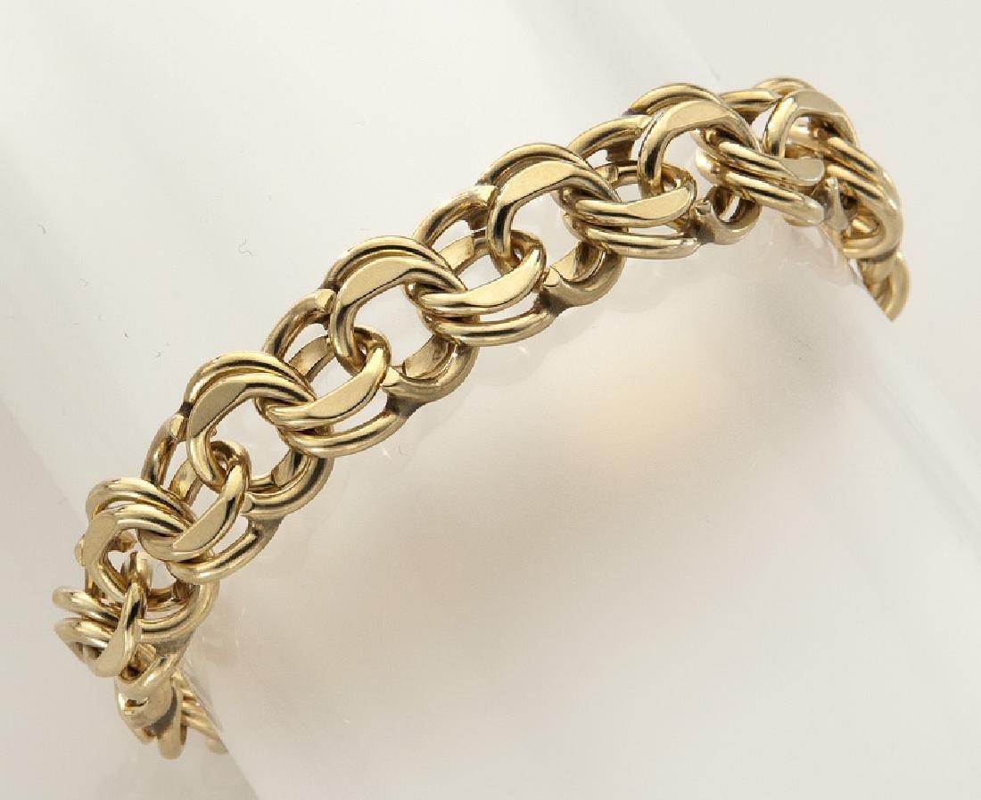 14K gold link charm bracelet.