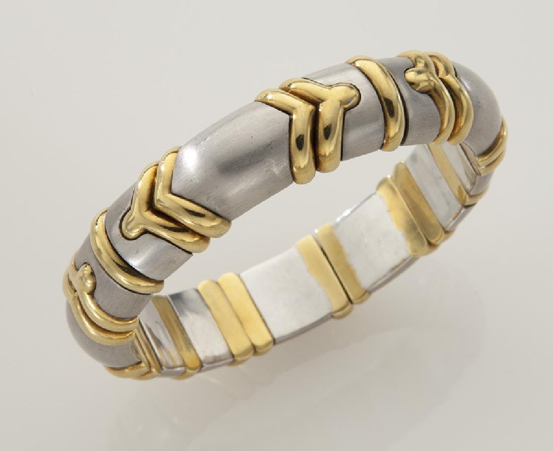 18K white and yellow gold bangle bracelet.