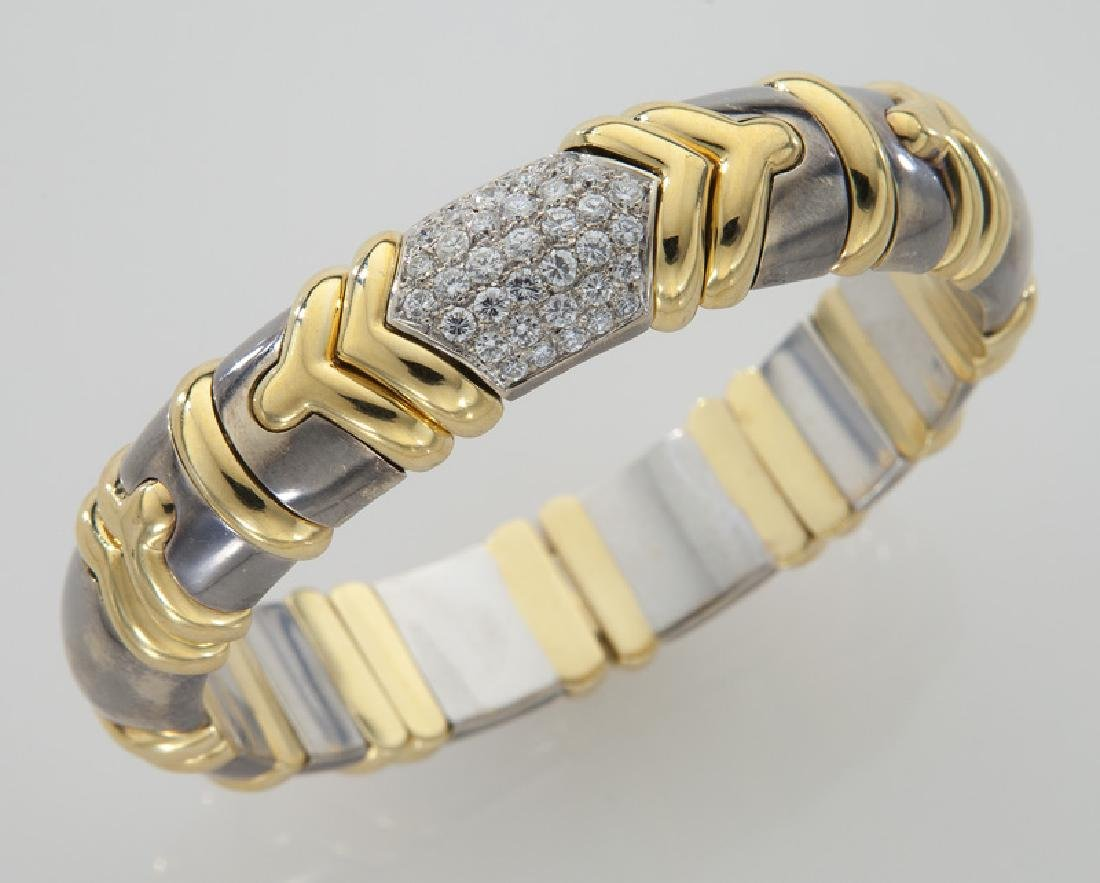 18K gold and diamond bangle bracelet.
