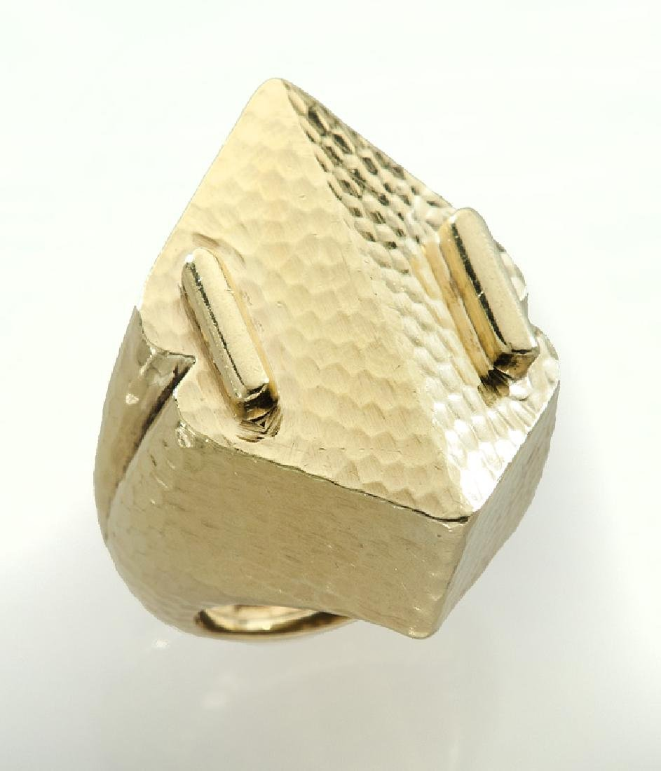 18K gold ring with a hammered finish.