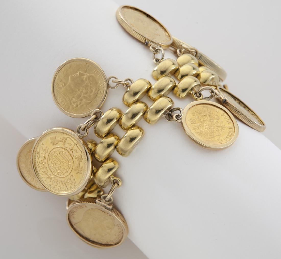 18K gold coin charm bracelet featuring 18 coins
