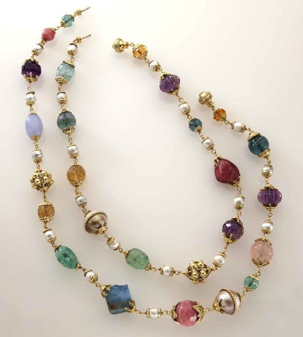 (2) Seaman Schepps 18K multi-baroque necklaces.