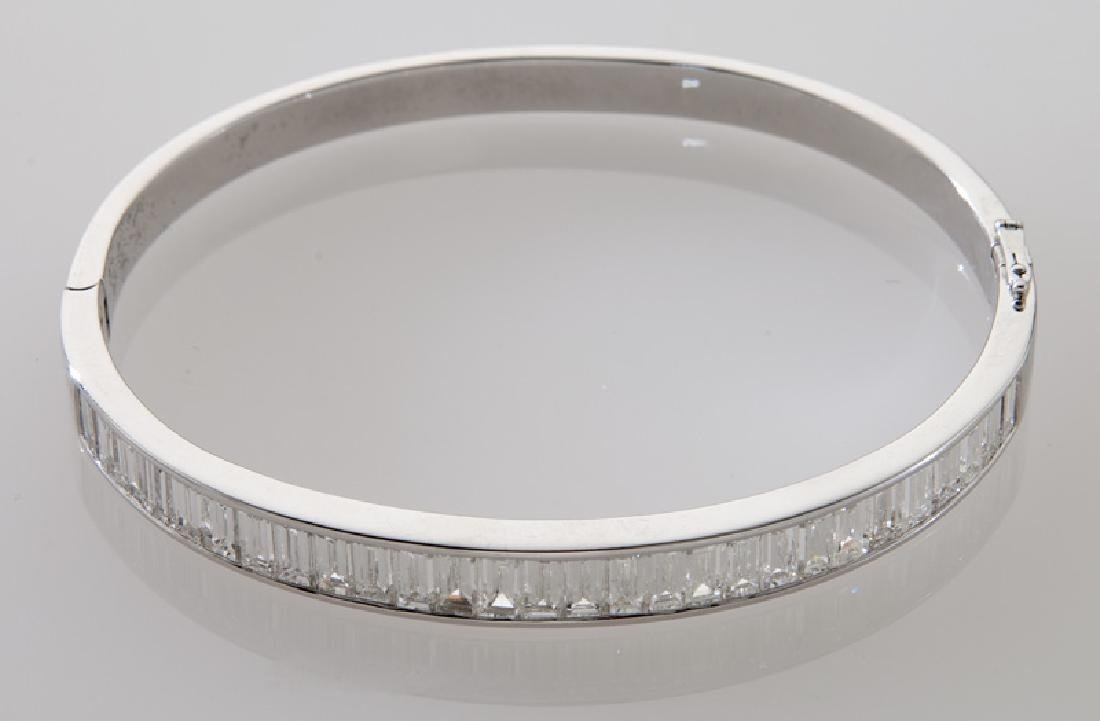 18K gold and baguette cut diamond bangle bracelet. - 2