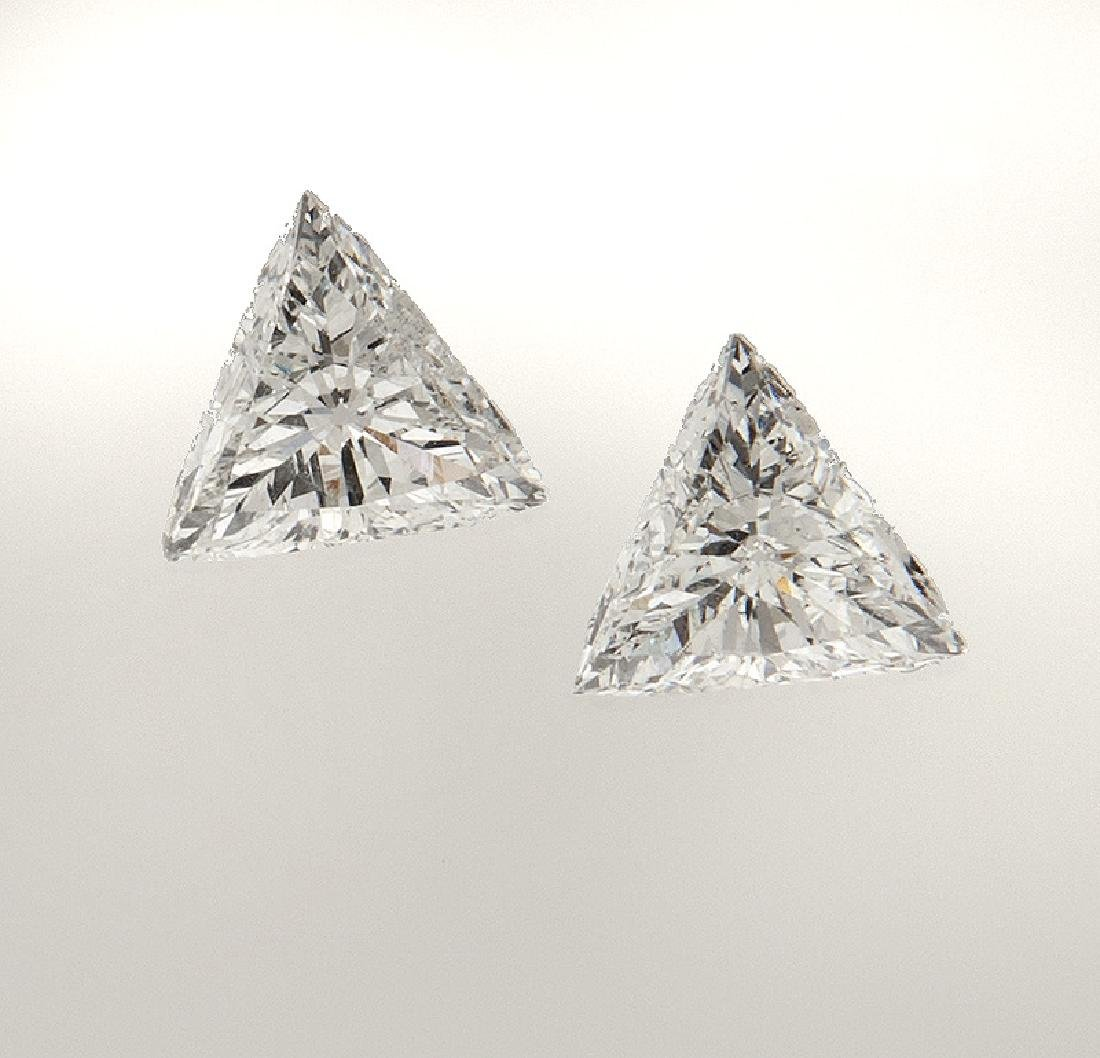 Pair of triangular brilliant cut diamonds,