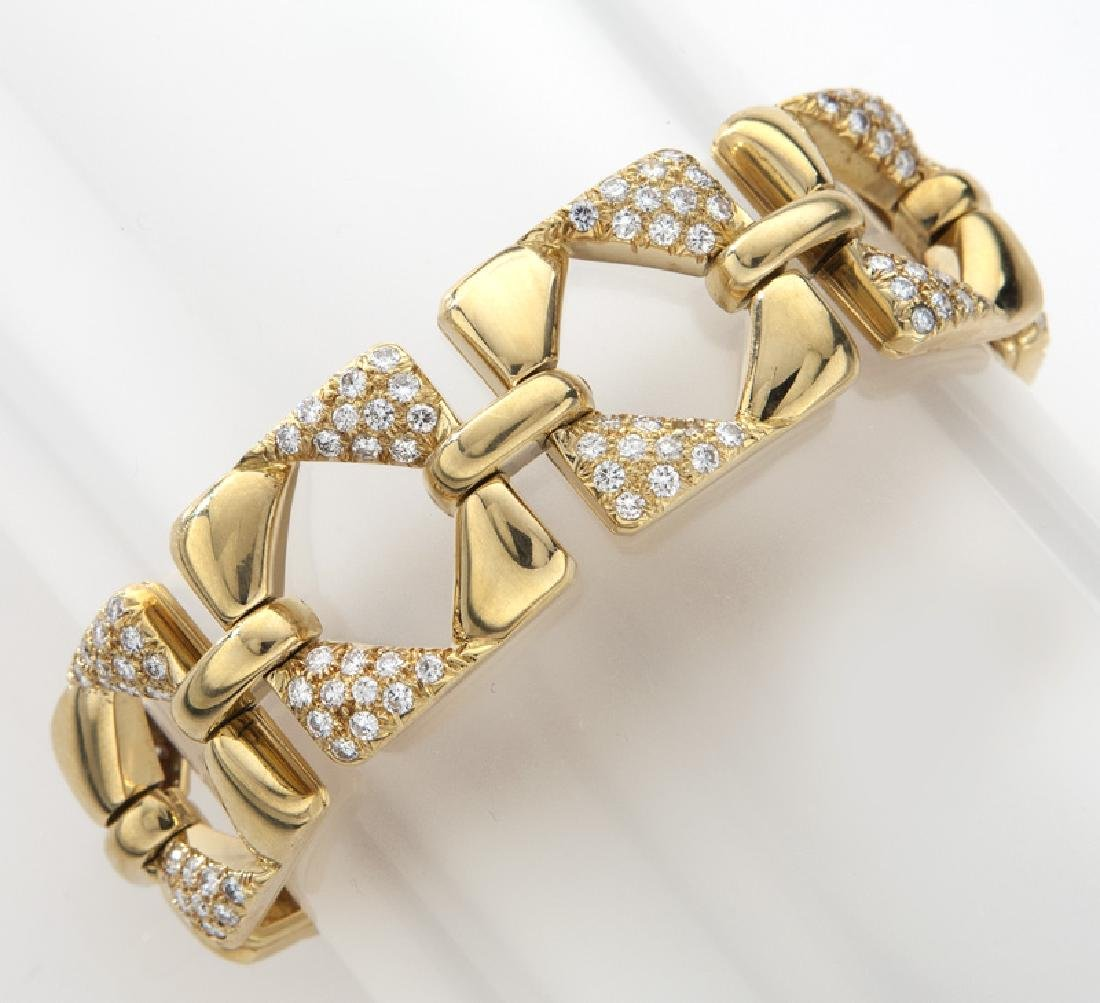 18K gold and diamond geometric link bracelet.