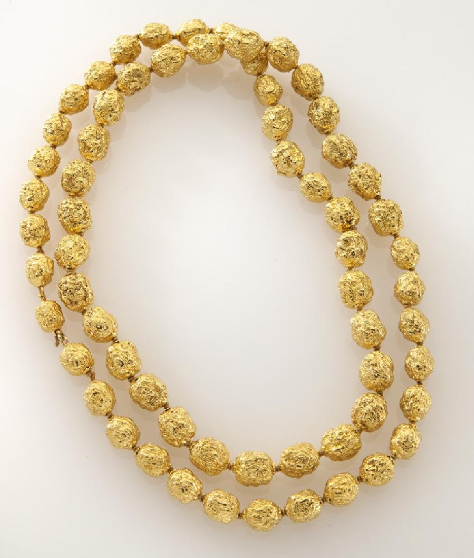 Italian 18K gold textured bead necklace.