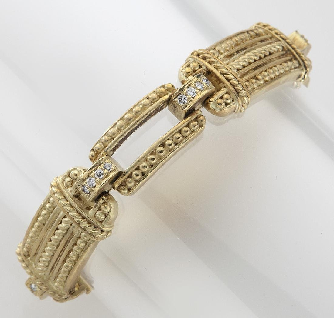 Judith Ripka 18K gold and diamond link bracelet.