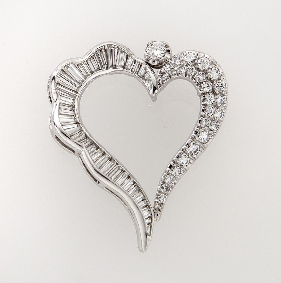 14K white gold and diamond heart pendant.