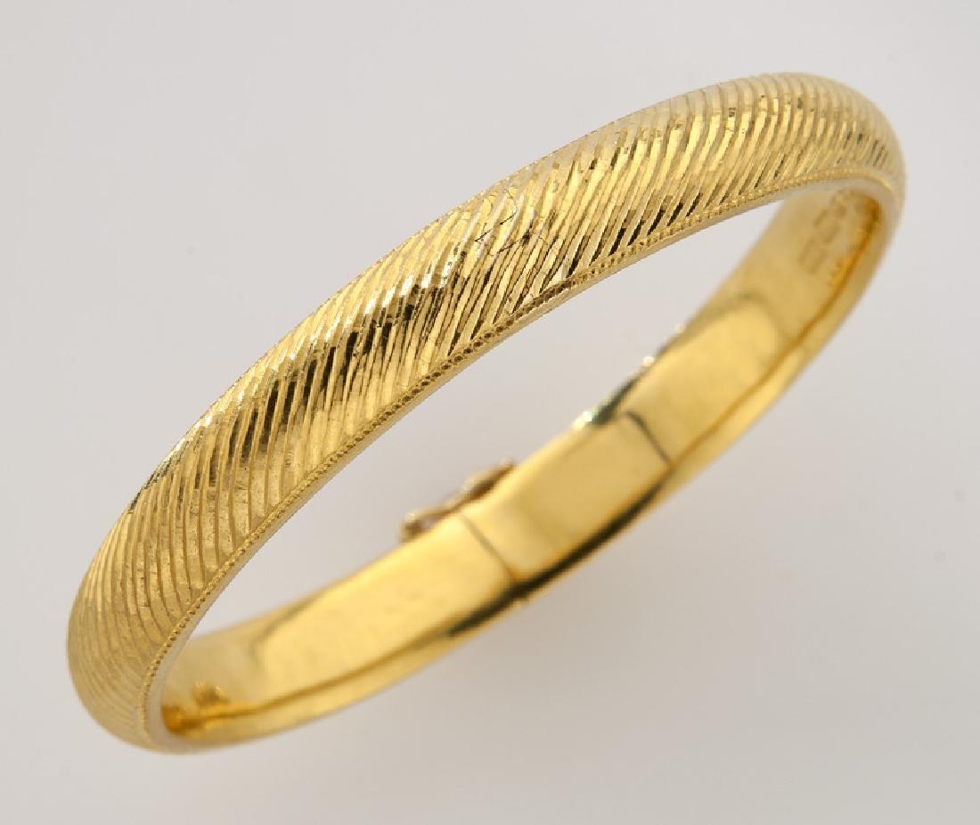 Chinese 24K gold bangle bracelet.