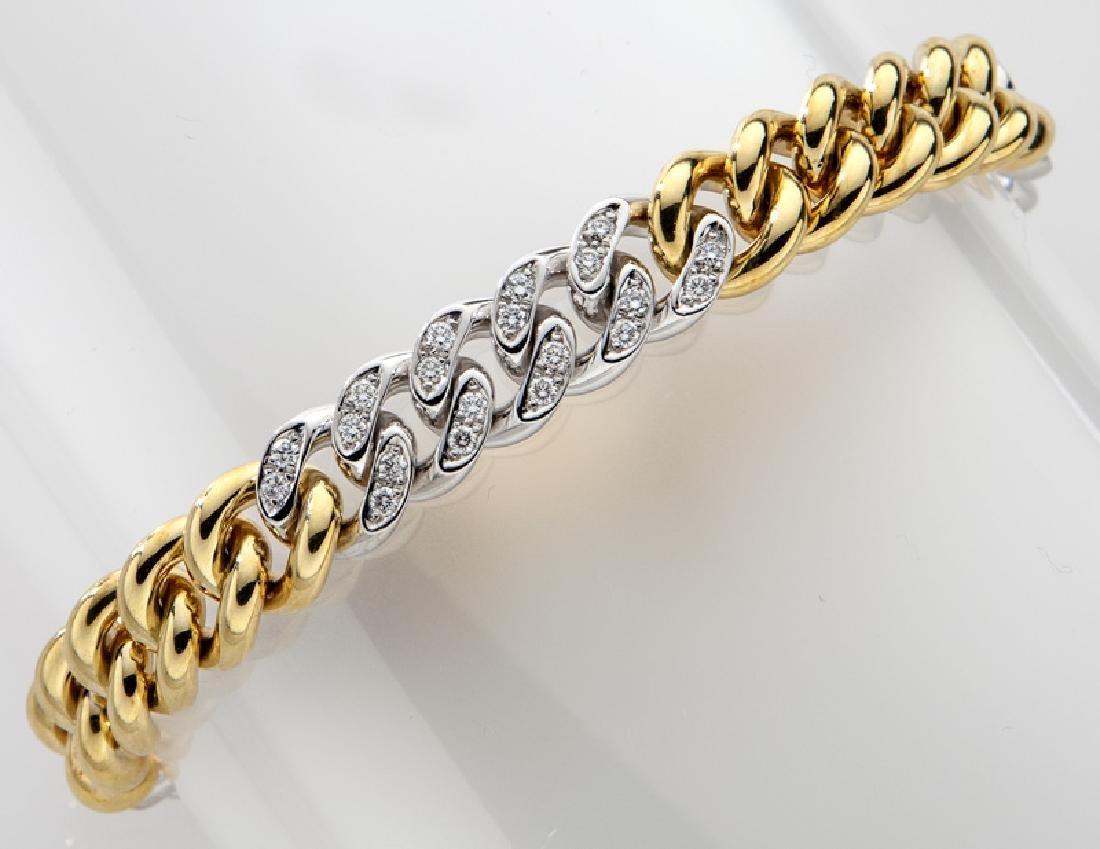 Handarbeit 18K gold and diamond link bracelet.