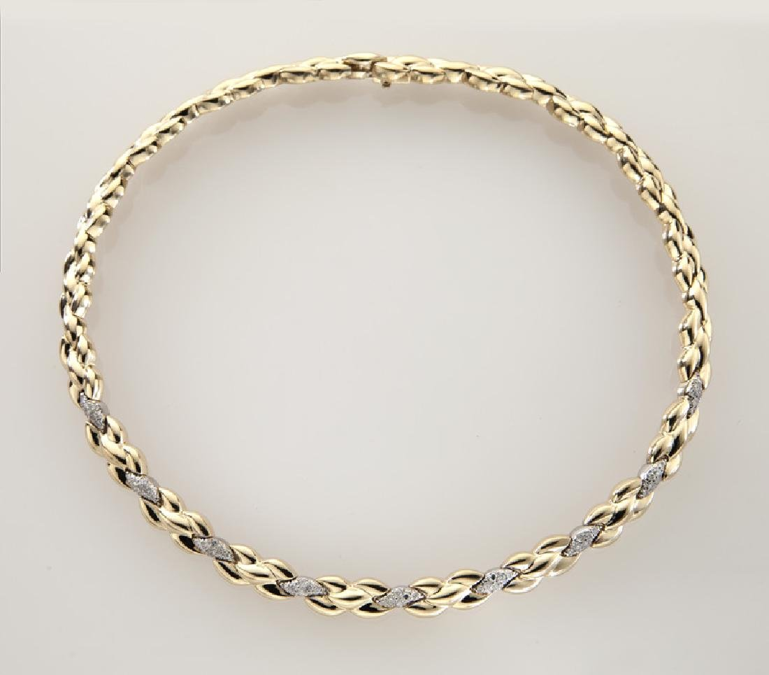 14K gold and diamond necklace.