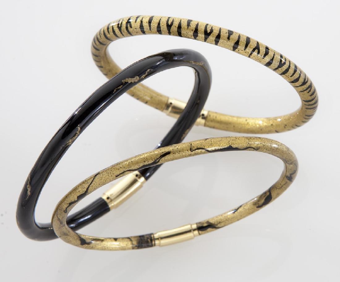 (3) 18K gold and enamel bracelets by Soho.