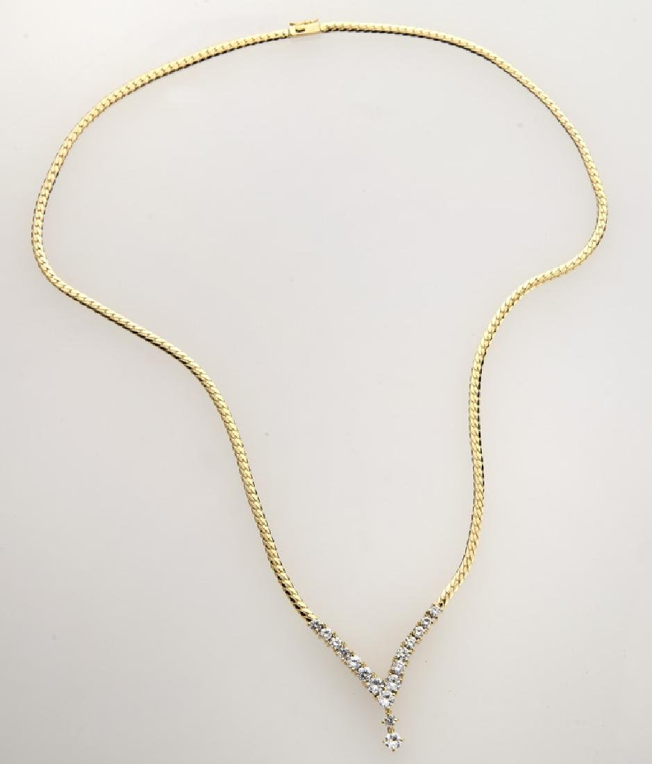 18K yellow gold and diamond necklace.