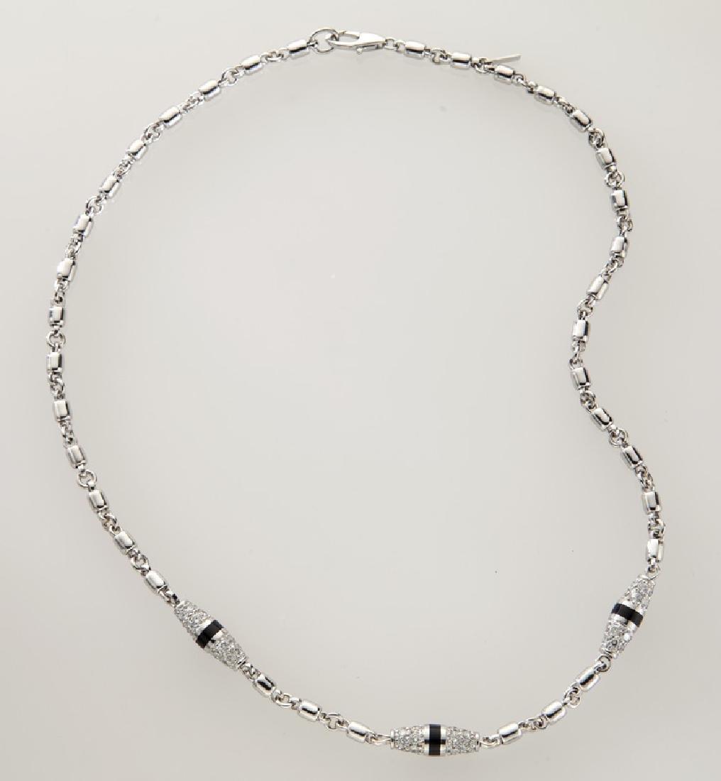 Platinum, 18K gold and diamond necklace.