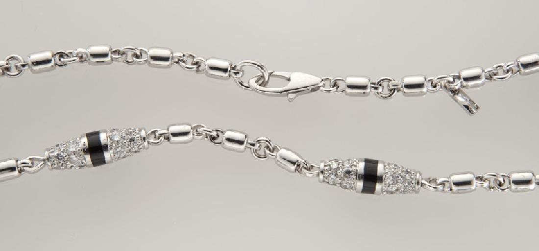 Platinum, 18K gold and diamond necklace. - 2
