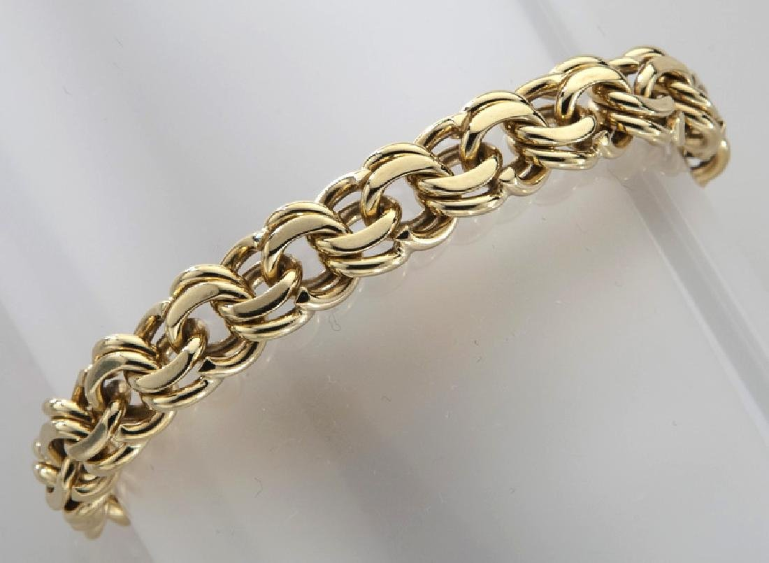 14K gold double link charm bracelet.