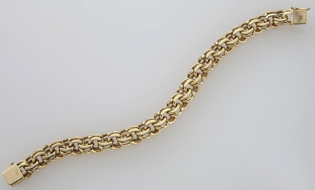 14K gold double link charm bracelet. - 3