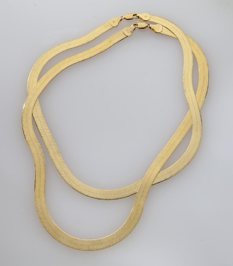 Pair 18K yellow gold herringbone chain necklaces.