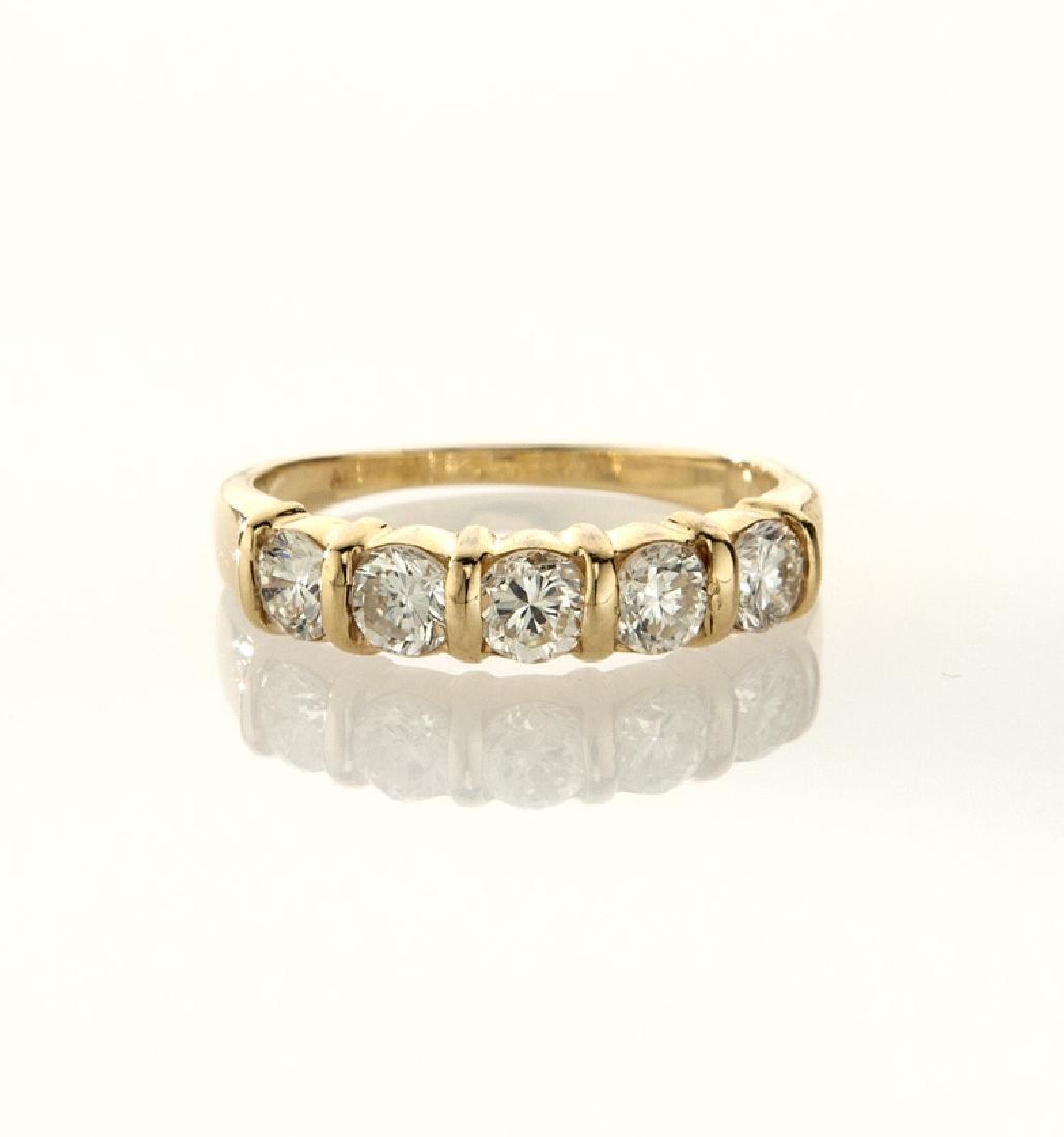 14K gold and diamond wedding band. - 2