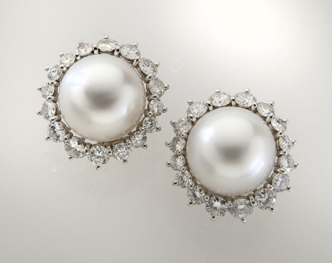 Pair of plat., diamond, South Sea pearl earrings,